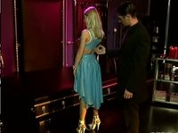 Chained blonde in a blue latex dress becomes an object of an experiment