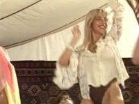 Traveling bedouins invite a blonde dancer for their entertainment