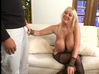 Mature blonde with the hugest tits can mesmerize anyone