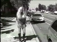 Mature hooker walks the street to find somebody willing to cum on her huge tits