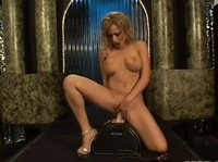 Blonde babe in red jumps up and down her suction dildo