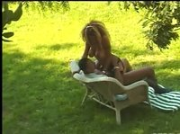 Black couple enjoy a nice day in the back yard