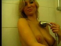 Blonde chick washes her amazing soft titties