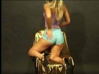 Golden blonde gets naked on a golden chair