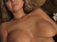 Skinny blonde is showing off her big tits