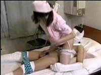 Asian nurse is keeping her patient alive