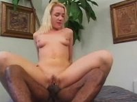 Two black guys share a young blonde pussy