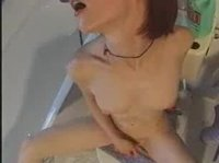 Horny babe seeks privacy in the toilet