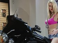 Blonde chick models on a black Harley