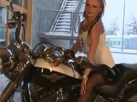 Sexy biker chick reveals her inner beauty on a motorcycle