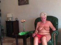 Mature blonde takes her underwear off