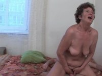 Horny granny jumps on a young hard cock