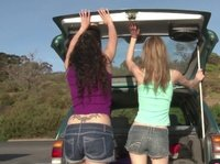Two young lesbian are looking for a private place to play in their car