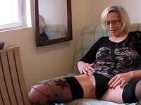 Blonde granny plays with her old pussy