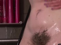 A very hairy mature pussy gets toyed in the shower