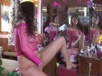 Young sexy chick plays by the mirror