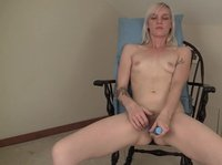 A young blonde is trying to entertain herself on the chair