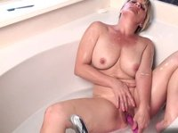 After a long hard day she relaxes in the bathtub with her vibrator