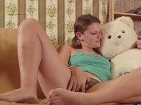 A barely legal babe humps her teddy bear