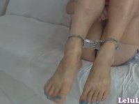 Lelu Love is cuffed at her ankles