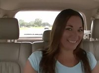 A college babe is flashing in the car
