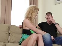 A mature blonde seduces a younger guy