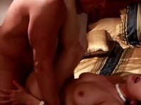 A horny couple fuck on golden sheets