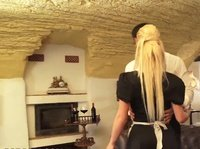A blonde tattooed maid offers very special services