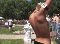A young blonde chick has fun at the festival