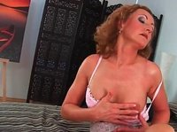 A mature redhead knows how to make a young guy lose his mind