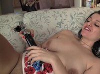 A horny chick fucks herself with a can opener