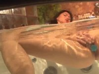 A hot Asian chick masturbates in a bathtub