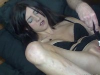 A dark-haired cutie lets her boyfriend to tease her with a vibrator