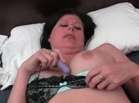 A mature brunette is showing the miracles of masturbation