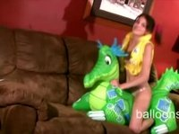 She doesn't have a boyfriend to ride, so she rides this rubber dino