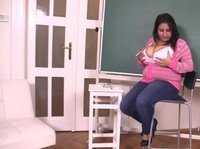 A shy students is playing with her huge melons in class