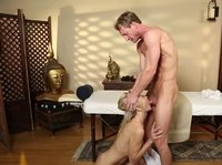 She quickly kneels to suck her masseur's cock