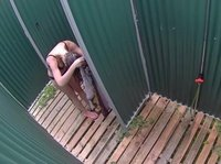 A young girl is taking a shower in front of a spycam