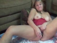 Hot milf is pleasuring herself with a big vibrator