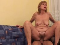A hot old granny enjoys a young hard cock