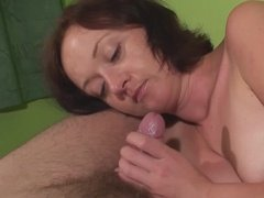 Whore milf sucks dick head and gives handjob